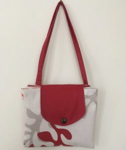 sac de plage plié en tissu enduit Corail rouge